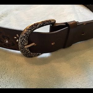 Brown bonded leather belt, flower cutouts, rivets